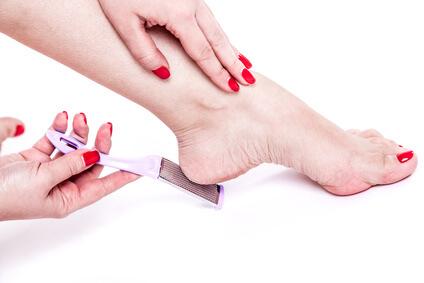woman treats dehydrated skin heels legs pedicure tool grater for heels